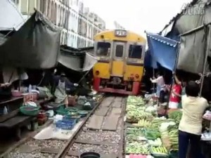 Train Passes Through Busy Farmers Market