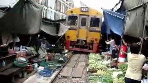 Unbelievable Train Passes Through Busy Farmers Market! | Train Fanatics Videos
