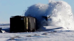 Snow Explodes Next To Parked Freight Cars!