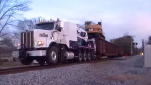 Big Rig Truck Pulling Train Freight On The Tracks!?