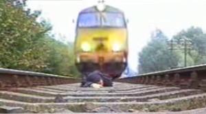Rail Trespasser Risks It All, Ducks Under Oncoming Train!