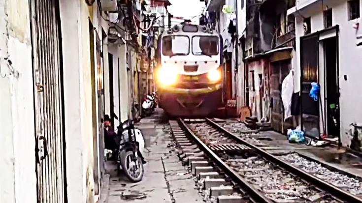 Train Gut Wrenchingly Passes Between Neighborhood Homes
