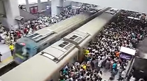 Beijing's Packed Subways Struggle To Keep Up!