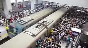 Beijing's Packed Subways Struggle To Keep Up!