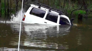 Man Drives Into River And Spectacularly Makes It Across!