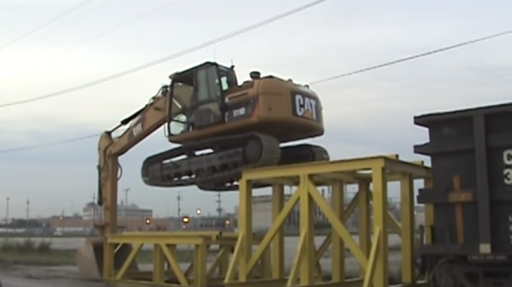 Caterpillar Climbs  Railcar To Unload Rock!   Train Fanatics Videos